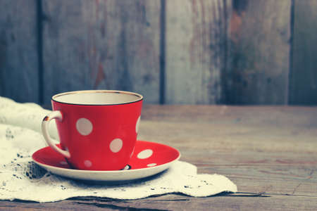 Red cup on wooden background Stock Photo