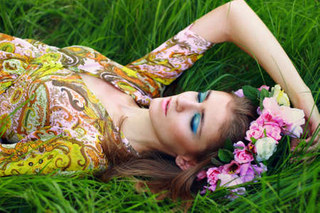 Young woman laying on the grass Stock Photo