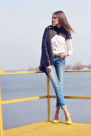 Young woman standing on yellow bridge Stock Photo