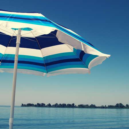 sun umbrella: Sun umbrella over blue sky