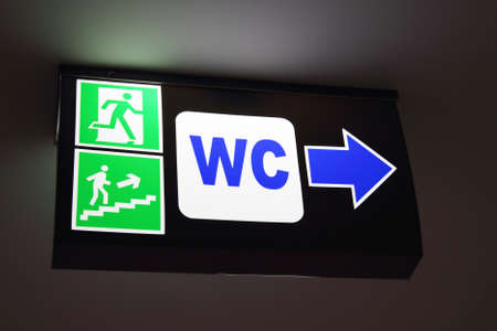 WC sign with arrow Stock Photo