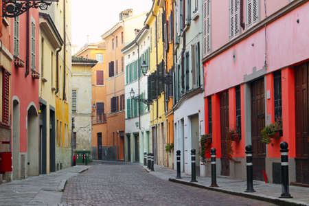 Old streets in Italian town with houses painted in different colors, Parma, Italy Stock Photo - 38510057