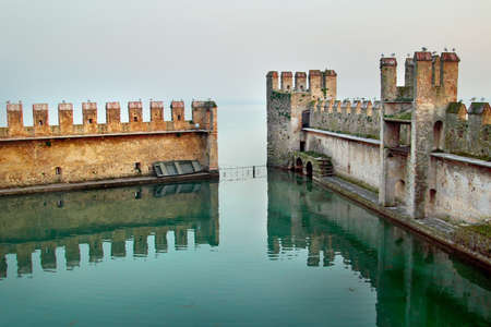 sirmione: Backwater inside the Scaliger Castle - medieval port fortress, Sirmione, Italy