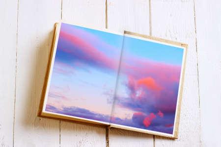 multiple exposure: Libro aperto con cielo. Effetto esposizione multipla � stato applicato.