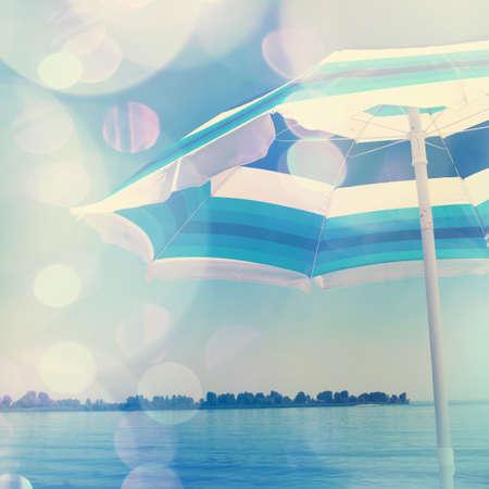 Sun umbrella on the beach. Bokeh effect has been applied.