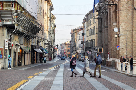 december 25: PARMA, ITALY - DECEMBER 25 2014: People walking across the street in Parma on DECEMBER 25, 2014, Italy. Editorial