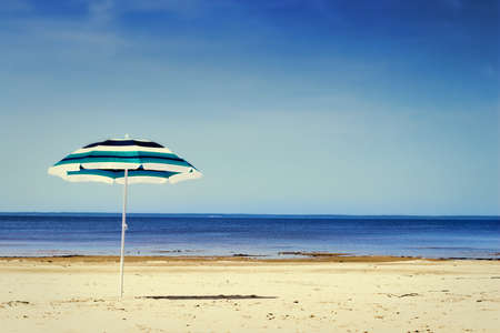 sun umbrella: Sun umbrella on sunny beach