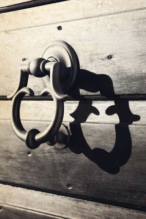 Old metal door handle, Italy photo