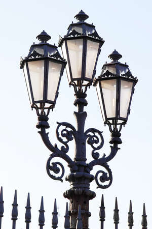 metal post: Street lantern with three lamps, Italy