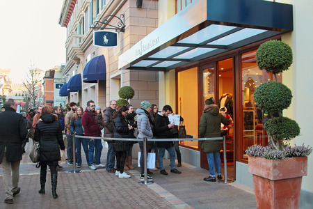 lining: FIDENZA, ITALY - JANUARY 3, 2015: People lining up at Ralph Lauren store. Winter sale season in Fidenza outlet village, Italy on January 3, 2015. Editorial