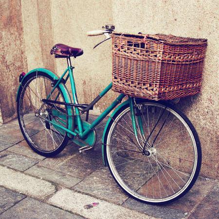 Old vintage Italian bicycle with big basket photo
