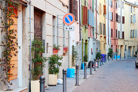 old center: PARMA, ITALY - JANUARY 12, 2015: Narrow street with colorful buildings  in historical old center of Parma, Italy. Editorial