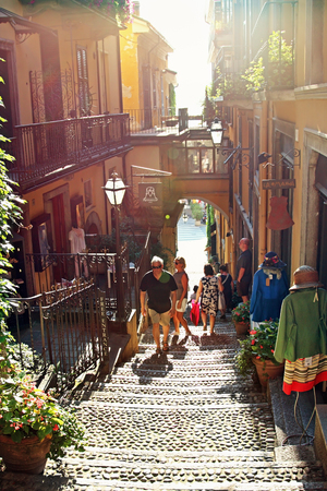 view of a staircase in a shop: BELLAGIO, ITALY - AUGUST 03, 2015: View of narrow old street with small shops  in old Bellagio, Como lake, Italy.