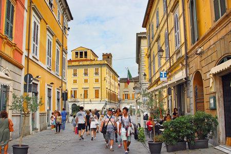 sarzana: SARZANA, ITALY - AUGUST 10, 2015: Old streets in Sarzana town, Italy. Bright  colored houses.