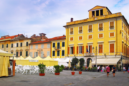 sarzana: SARZANA, ITALY - AUGUST 10, 2015: Central square - Piazza Giacomo Matteotti in old town of Sarzana, Italy. Preparation for local food festival that takes place every year in August.