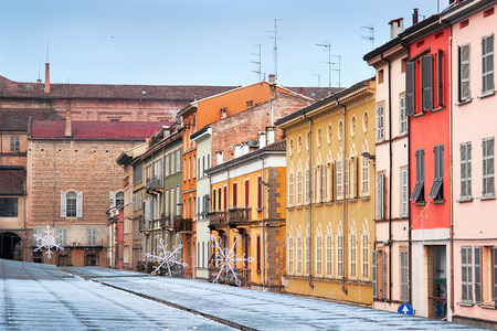 december 31: PARMA, ITALY - DECEMBER 31, 2014: View of Piazza Ghiaia square in Parma town, Italy. Houses builded tightly to each other.
