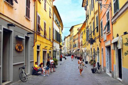 sarzana: SARZANA, ITALY - AUGUST 10, 2015: Streets in Sarzana, Italy. Historic colored buildings.