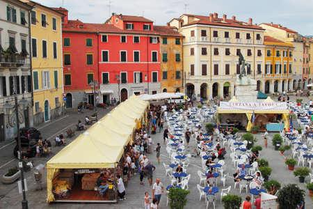 sarzana: SARZANA, ITALY - AUGUST 10, 2015: People enjoying local cuisine at the historic square - Piazza Giacomo Matteotti in old Sarzana, Italy.