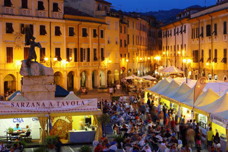 sarzana: SARZANA, ITALY - AUGUST 10, 2015: People tasting traditional Italian food in the evening at the square - Piazza Giacomo Matteotti in Sarzana, Italy. Editorial