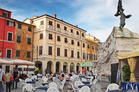 sarzana: SARZANA, ITALY - AUGUST 10, 2015: People enjoying open air local cuisine at the historic square - Piazza Giacomo Matteotti in historic Sarzana, Italy.