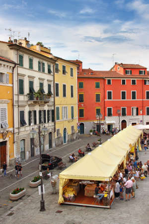 sarzana: SARZANA, ITALY - AUGUST 10, 2015: People celebrate festival of Italian traditional cuisine at historical square - Piazza Giacomo Matteotti in Sarzana, Italy. Local traditional food is famous among tourists. Editorial