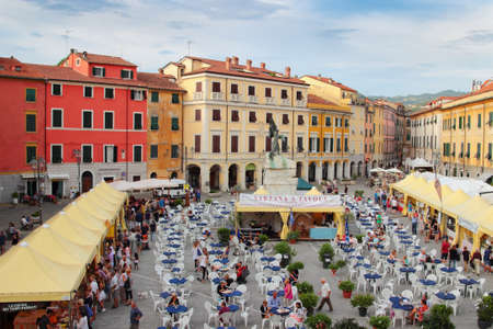sarzana: SARZANA, ITALY - AUGUST 10, 2015: Central historic square - Piazza Giacomo Matteotti in Sarzana town, Italy. People celebrate the local food fair that starts  every summer in August. Editorial