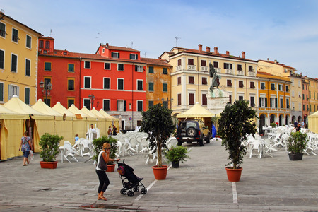 sarzana: SARZANA, ITALY - AUGUST 10, 2015: Old square - Piazza Giacomo Matteotti in small historic town of Sarzana, Italy. Tents and chairs are prepared for local food fair that goes several evenings in every August.