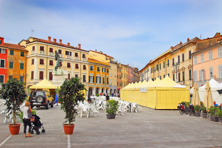 sarzana: SARZANA, ITALY - AUGUST 10, 2015: Center square - Piazza Giacomo Matteotti in medieval town of Sarzana, Italy. Tents are prepared for local food fair that takes place every year in August. Editorial