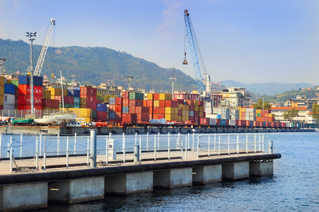 spezia: LA SPEZIA, ITALY - AUGUST 08, 2015: La Spezia marine cargo port with multiple containers in summer sunny day.
