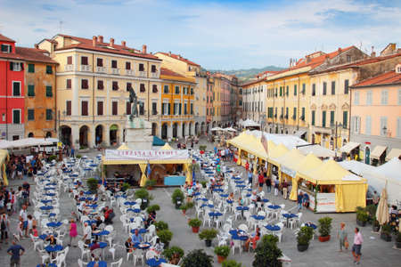 sarzana: SARZANA, ITALY - AUGUST 10, 2015: Historic square - Piazza Giacomo Matteotti in old Sarzana, Italy. People enjoy the local food fair that begins in every August.