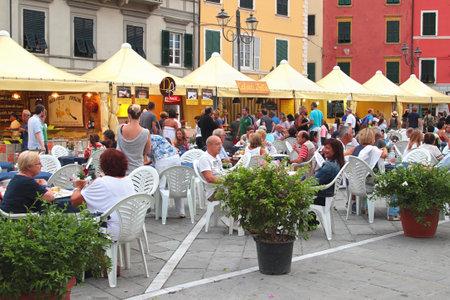 sarzana: SARZANA, ITALY - AUGUST 10, 2015: Many people at local food fair at the central old square - Piazza Giacomo Matteotti in Sarzana, Italy. Editorial