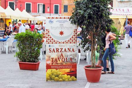 sarzana: SARZANA, ITALY - AUGUST 10, 2015: Signboard of the local cuisine festival at the old square - Piazza Giacomo Matteotti in Sarzana, Italy.