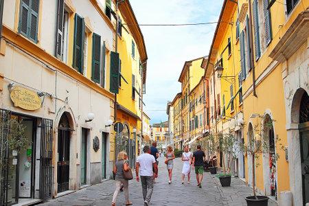 sarzana: SARZANA, ITALY - AUGUST 10, 2015: Streets in old town of Sarzana in the evening, Italy. People walking.