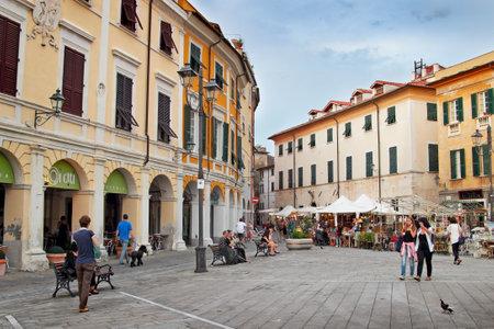 sarzana: SARZANA, ITALY - AUGUST 10, 2015: People walking at the square in old town of Sarzana, Italy. Festival of retro objects.