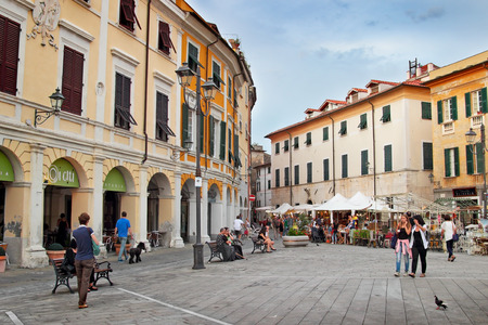SARZANA, ITALY - AUGUST 10, 2015: People walking at the square in old town of Sarzana, Italy. Festival of retro objects.