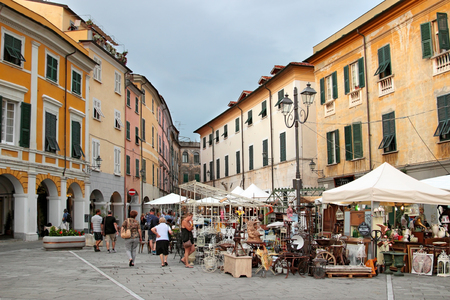 SARZANA, ITALY - AUGUST 10, 2015: People walking at the festival of old retro objects in small town of Sarzana, Italy. Editorial