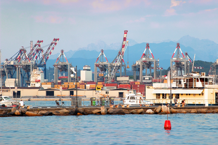 spezia: LA SPEZIA, ITALY - AUGUST 08, 2015: Cargo port and loading mechanisms in La Spezia, Liguria province, Italy.