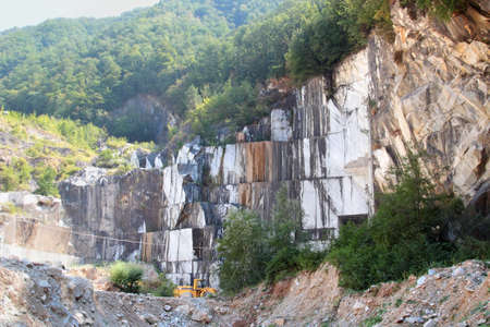 not open: Open quarry for white marble extraction in the Apennines, not far from Carrara, Italy.