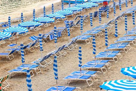 sun umbrellas: Many sun umbrellas on sand beach, Italy.