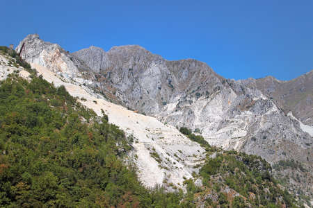 tuscana: Open quarrying of white marble blocks in the Apennines, Tuscana province, Carrara, Italy. Stock Photo