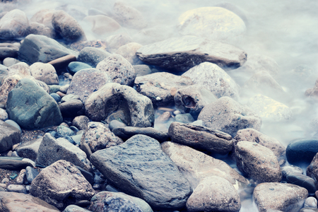 filtered: Stones at sea shoreline. Color filtered imaged.