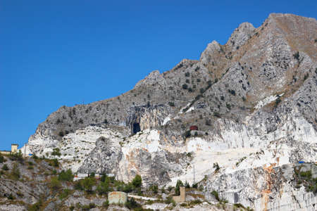 tuscana: View of the mountain with marble quarries in Apennines moutains, Tuscana region, near Carrara, Italy. Open marble quarrying.