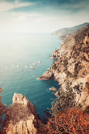 sea cliff: View above Ligurian coast, Cinque Terre, Italy. Yachts and boats sailing at the sea. Color toning effect applied. Stock Photo