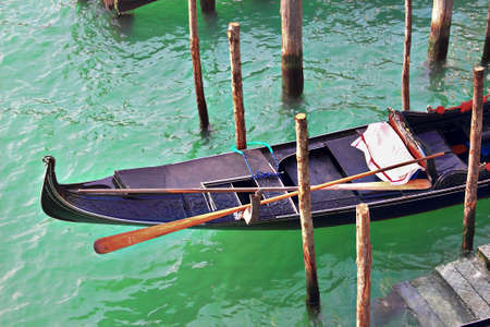 six persons: Gondola boat in Venice, Italy. Traditional transportation vehicle in the city with many canals. Up to six persons can be placed in it.