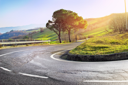 to bend: Hairpin bend of the asphalt road at the Apennines mountains, Italy.
