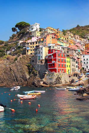seaside town: Scenic seaside town in summer, Riomaggiore, Cinque Terre National park, Luguria region, Italy. Stock Photo