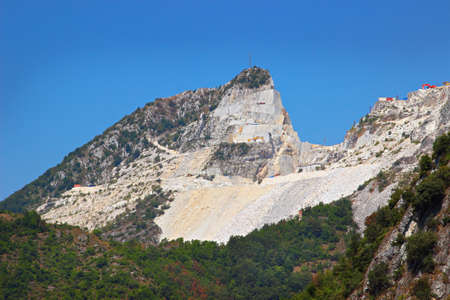 moutains: High rocky mountain where marble quarries are located, Apennines moutains in Tuscana region, Carrara, Italy. Open marble extraction.