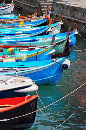 vernazza: Colorful boats in sea port, Vernazza, Cinque Terre, Italy.