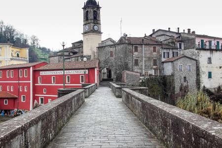 Old road to medieval castle in Villafranca, Lunigiana, Tuscany region, Italy.