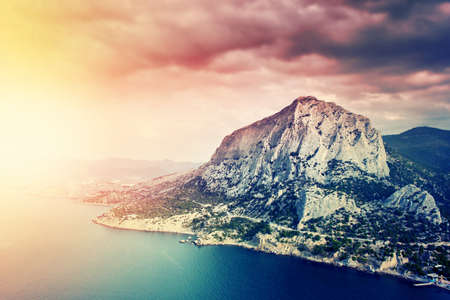 filtered: Landscape with mountains and sea. Filtered image.